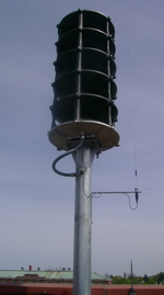 Whelen Omni Siren with radio antenna